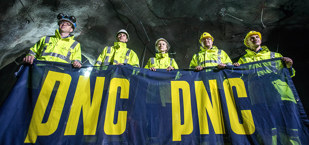 Employees of the Bekkelaget sewage plant holding a PNC banner.